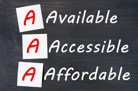 affordable: Acronym of AAA - available, accessible. affordable written on a blackboard with sticky notes