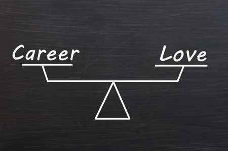 Balance of career and love on a Smudged wooden blackboard background Stock Photo - 14383619