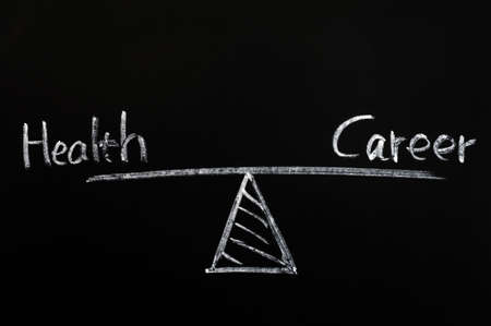 Balance of health and career drawn with white chalk on a blackboard photo