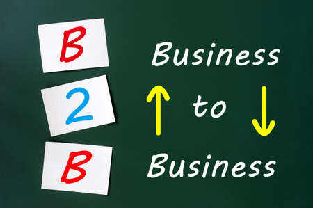Conceptual B2B acronym on a green chalkboard (business to business) photo