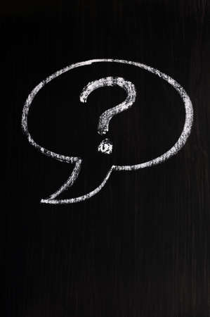 Chalk drawing of speech bubble with question mark on a blackboard background Stock Photo - 14462017