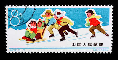 CHINA - CIRCA 1965: A Stamp printed in China shows image of skiing children, circa 1965  photo