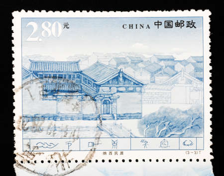 cancellation: CHINA - CIRCA 2002: A Stamp printed in China shows the famous Naxi dwellings in Lijiang Yunnan, circa 2002 Stock Photo