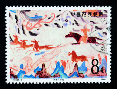 A stamp printed in China shows Chinese ancient wall painting art, circa 1988