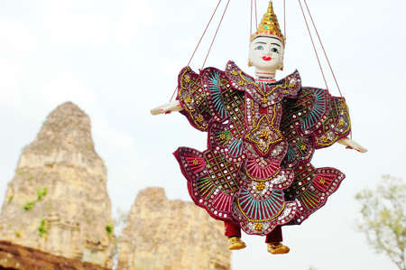 reap: Scenery of puppet at Angkor, Cambodia, with Angkor wat relics as background