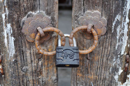 Iron doorknob or knockers on an old gate photo