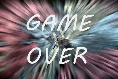 Game over written with white chalk on a background of motion rays photo
