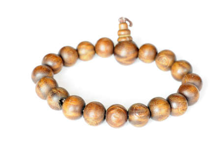 Wooden buddhist beads on a white background photo
