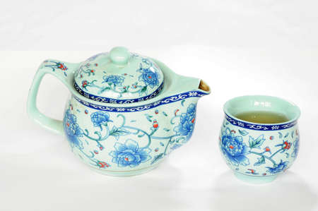 chinese tea pot: Chinese pottery teaset on a white background Stock Photo