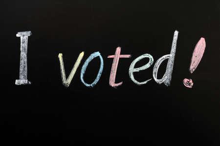 głosowało: Głosowałem - słowa napisane na tablicy Zdjęcie Seryjne