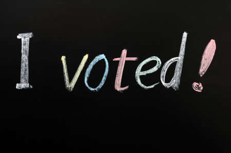 voted: I voted - words written on a blackboard