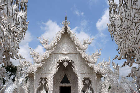 buddhist temple roof: Famous landmark of White Temple in Chiang Rai, Thailand Stock Photo