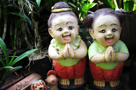 red clay: Smiling lovely Thai Greeting doll for welcome