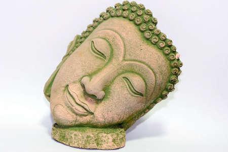 buddha face: Buddha portrait souvenir made of sand-stone from Thailand