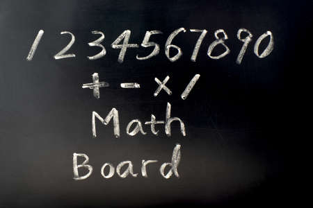 Math board with numbers written with chalk photo