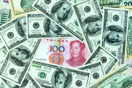 valorization: Pile of USD and RMB bank notes as money background
