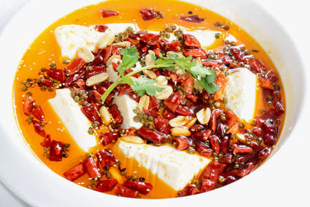 bean curd: Chinese Food: Boiled Tofu with red pepper in a white plate