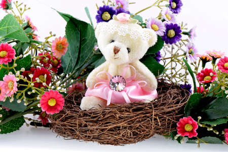 welcome home: Nest with a Teddy Bear on a blooming background