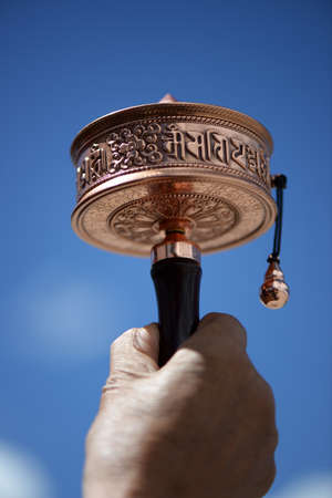 spiritual architecture: Prayer Wheel against blue sky in Tibet Stock Photo