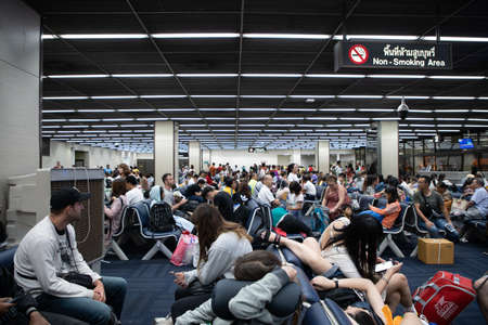 DON MUEANG INTERNATIONAL AIRPORT, DON MUEANGTHAILAND - JULY 25: Airport corridor and passenger in waiting room Travel Preparation, Uncultured People are busy on 07 25 2018 Editorial