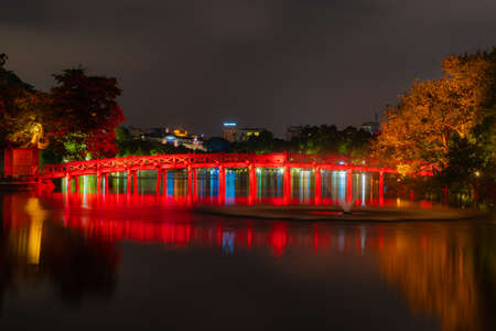 OLD QUARTER, HANOI/VIETNAM - JULY 28: Night view of The Huc bridge and Ngoc Son temple on 07 28 2018 in Lake of the Returned Sword, Lake of the Restored Sword, Hoan Kiem Lake.
