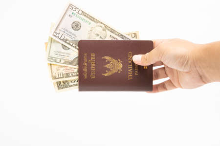 Us dollar in Thailand passport on hand isolated on white background.