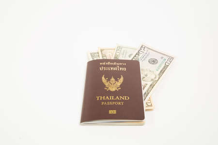 Us dollar in Thailand passport and isolated on white background.