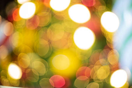 Abstract colorful lights blur and beautiful bokeh of Christmas Tree yellow, red, blue, green, gold Chrismas, New Year Vintage style. Stock Photo