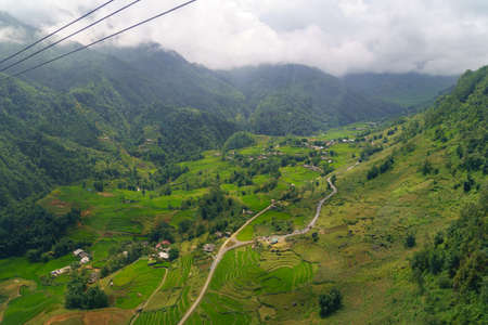 Inside view Cable car in the middle of the valley, fog in cloud background of country going to Fansipan mountain SAPA VIETNAM.