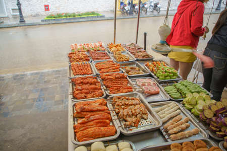 Grilled Foods of frog, chicken, vegetable, boar, pig spice ferment hot and spicy. BBQ Street food local delicacy in SAPA VIETNAM. Food is not clean. Stock Photo