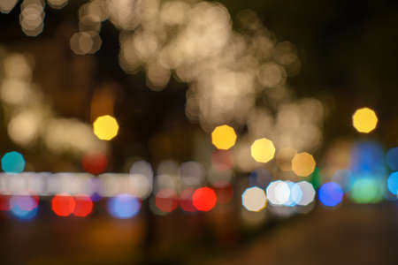 Abstract colorful lights blur and beautifu Vintagel bokeh enneagon street lights black background Night life  on the road. Stock Photo