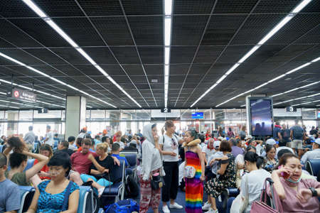 DON MUEANG INTERNATIONAL AIRPORT, DON MUEANG/THAILAND - JULY 12: Airport corridor walkway and passenger in waiting room travel preparation, uncultured many people are busy turbulence on 07 12 2019