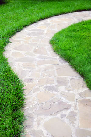 path on a garden surrounded grass