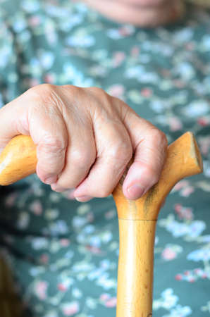 a wrinkled hand on cane photo