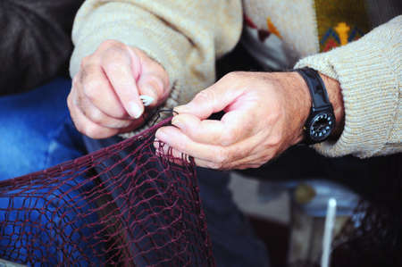 hand and fishing net photo