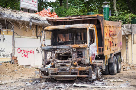 recap: ISTANBUL, TURKEY - JUNE 06, 2013: Damaged vehicle at Gezi Park Public Protest against the government. Editorial