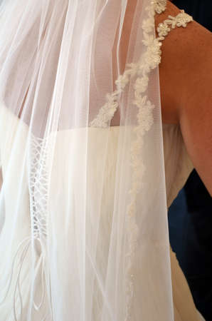 back of a bride in her dress photo