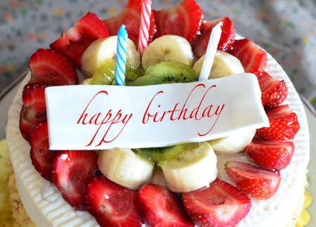 strawberry cake: birthday cake with \happy birthday\ tag