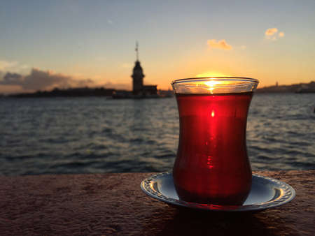 a glass of turkish tea against Tower at sunset in Istanbul Zdjęcie Seryjne
