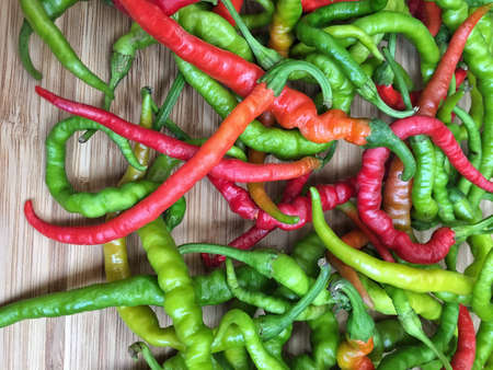 chiles picantes: colorful fresh hot peppers as a background