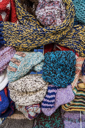 winter fashion: knitted hats and scarfs as a background