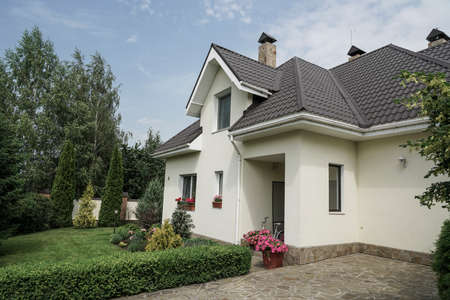 A new house with a garden in a rural area under beautiful sky Zdjęcie Seryjne