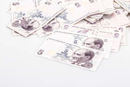 Some Turkish lira banknotes on white