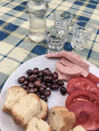Greek raki that is a local drink on table in Greece.