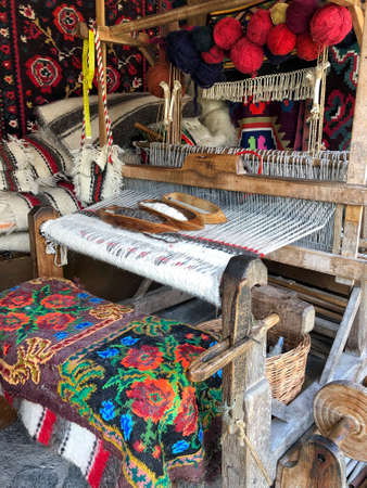 closeup of a weaving loom with colorful ropes in Romania 写真素材