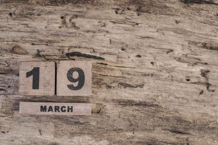 cube calendar for march on wooden background with copy space Stock Photo