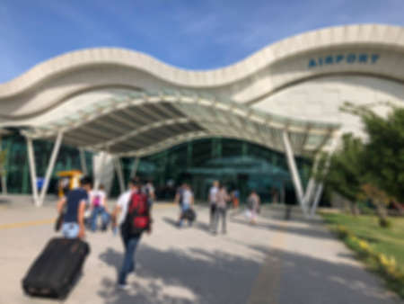 Blurred background with people entering into a airport in the daytime Stock Photo