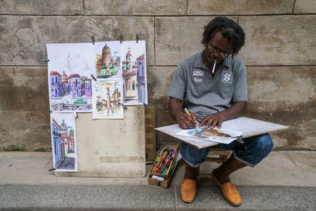 Havana, Cuba - May 01, 2017; A street artist doing paintings as souvenirs in the street of Havana in Cuba