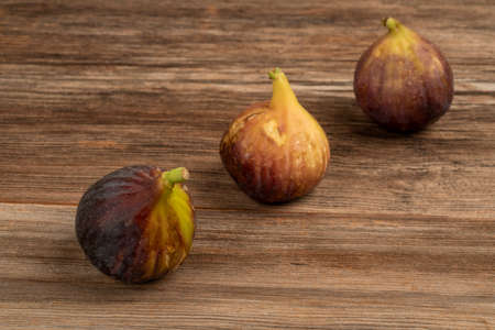 fresh and ripe figs on a wooden table with copy space