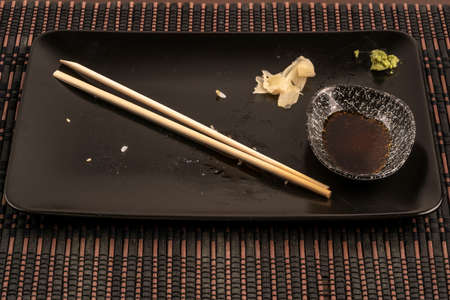 left overs after eating sushi with chopsticks on table